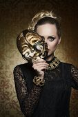 picture of gothic female  - cute blonde female with antique lady style covering her face with precious mask and looking in camera - JPG