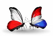 Two Butterflies With Flags On Wings As Symbol Of Relations Poland And Luxembourg