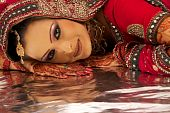 stock photo of rajasthani  - Beautiful Asian Bridal in Wedding Red Dress - JPG