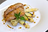 foto of giblets  - Sweetbreads asparagus and artichoke on a plate - JPG