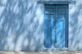 Blue House In Shadows