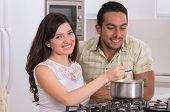 happy attractive couple cooking together