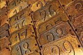stock photo of flea  - Numbers on rusty metal plates in a flea market - JPG