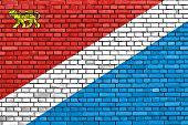 flag of Primorsky Krai painted on brick wall