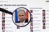 Photo Of President Putin On The Background Of The Sanctions List Through A Magnifying Glass At The S