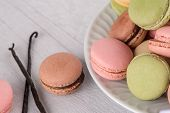 stock photo of french pastry  - Classic Macarons with Raspberry Coffee Chocolate and Pistachios Filled with Cream French Pastry - JPG