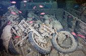 stock photo of wrecking  - Old motorbikes on the wreck of the Thistlegorm - JPG