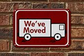 stock photo of truck  - We have Moved Sign A red sign with the word We - JPG