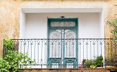picture of scrollwork  - Old ornate balcony in the small village of Athitos - JPG