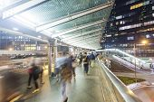 pic of commutator  - Commuters walking along an elevated walkway in downtown district in Hong Kong - JPG