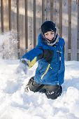 Child Playing Throwing Snow In Winter
