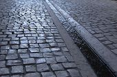 stock photo of gutter  - Paved street and gutter in the city - JPG