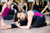 picture of bend  - Sporty teenage yogi girl exercises  - JPG