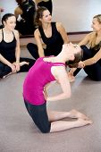 Sporty Yogi Girl Doing Yoga Camel Pose, Bends Backwards In Class