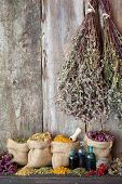 Healing Herbs In Hessian Bags Near Old Wall, Herbal Medicine.
