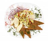 picture of rocket salad  - Rocket salad with pine nuts served with bread on white plate - JPG
