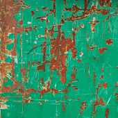 Painted green rusty metal surface