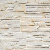 Wall of carved limestone bricks