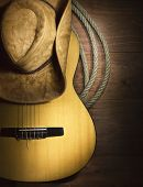 Country Music With Guitar On Wood Background