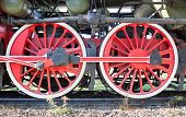 foto of train-wheel  - Big red steam train wheels close up - JPG