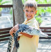 Boy with crocodile.