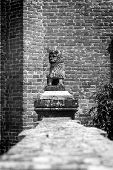 Decorative monument in the shape of lion. Black and white photo
