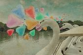 stock photo of pedal  - Colorful heart love balloon float on air with swan pedal boat at public park vintage style - JPG