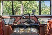 pic of cabs  - Detailed view of antique tractor cab with steering wheel - JPG