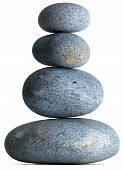 Four Pebbles Stones Balancing On Each Other On A White Background