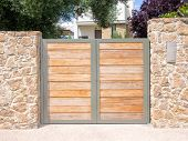 image of gate  - Solid wooden security gates protecting a house - JPG
