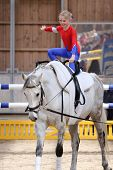 foto of vault  - young girl is vaulting on a big white horse - JPG