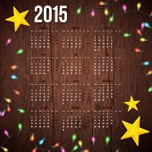 Wooden background, realistic garland and decorative stars with 2