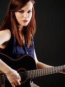 Young Beautiful Woman Playing Acoustic Guitar