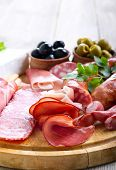 image of cheese platter  - Catering platter with different meat and cheese products - JPG