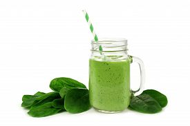 stock photo of smoothies  - Healthy green smoothie with spinach in a jar mug isolated on white - JPG