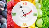 stock photo of vegetable food fruit  - Food clock with vegetables and fruits as background - JPG