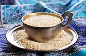 pic of sesame seed  - Sesame seeds in a metal Cup on a saucer - JPG
