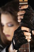 picture of guitarists  - Guitarist holding her electric guitar - JPG