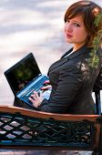 Young Girl With Laptop In The Park
