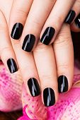 pic of black woman spa  - Beautiful women hands with black manicure after Spa procedures  - JPG