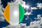 image of ivory  - balloon in colors of ivory coast flag flying on blue sky