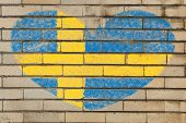 stock photo of sweden flag  - heart shaped flag in colors of Sweden on brick wall - JPG