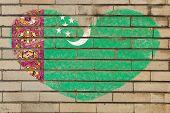foto of turkmenistan  - heart shaped flag in colors of turkmenistan on brick wall - JPG