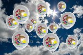 stock photo of illinois  - many ballons in colors of illinois flag flying on sky - JPG