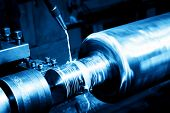 foto of turn-up  - Industrial turning machine at work close - JPG