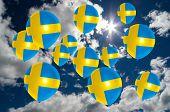 stock photo of sweden flag  - many ballons in colors of sweden flag flying on sky - JPG