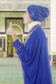 stock photo of muslimah  - Beautiful muslim woman praying in the mosque - JPG