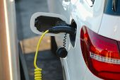 picture of electric station  - Electric car at a charging station - JPG