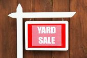 pic of yard sale  - Wooden Yard Sale sign on wooden fence background - JPG