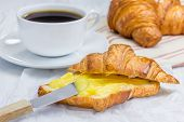 image of curd  - Fresh croissant with lemon curd and cup of coffee  - JPG